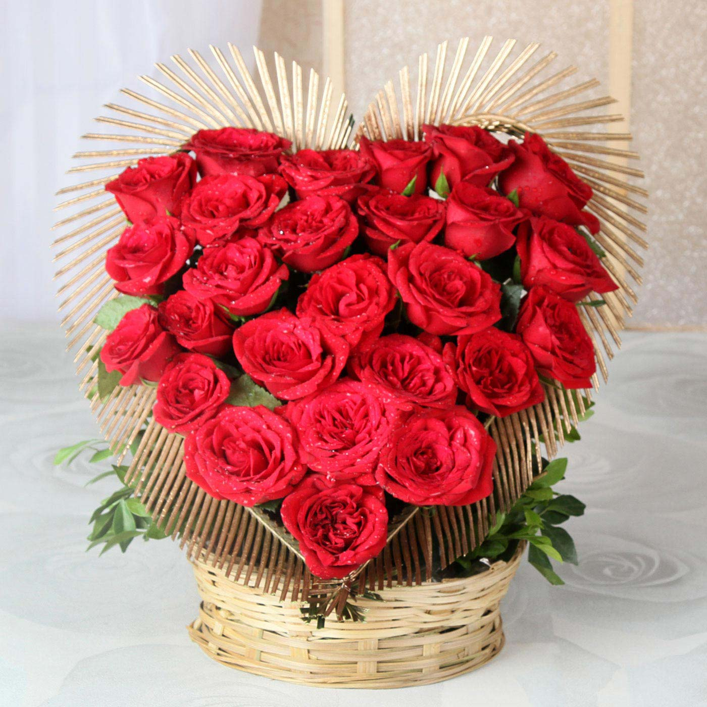 heart shaped basket of 25 exotic red roses