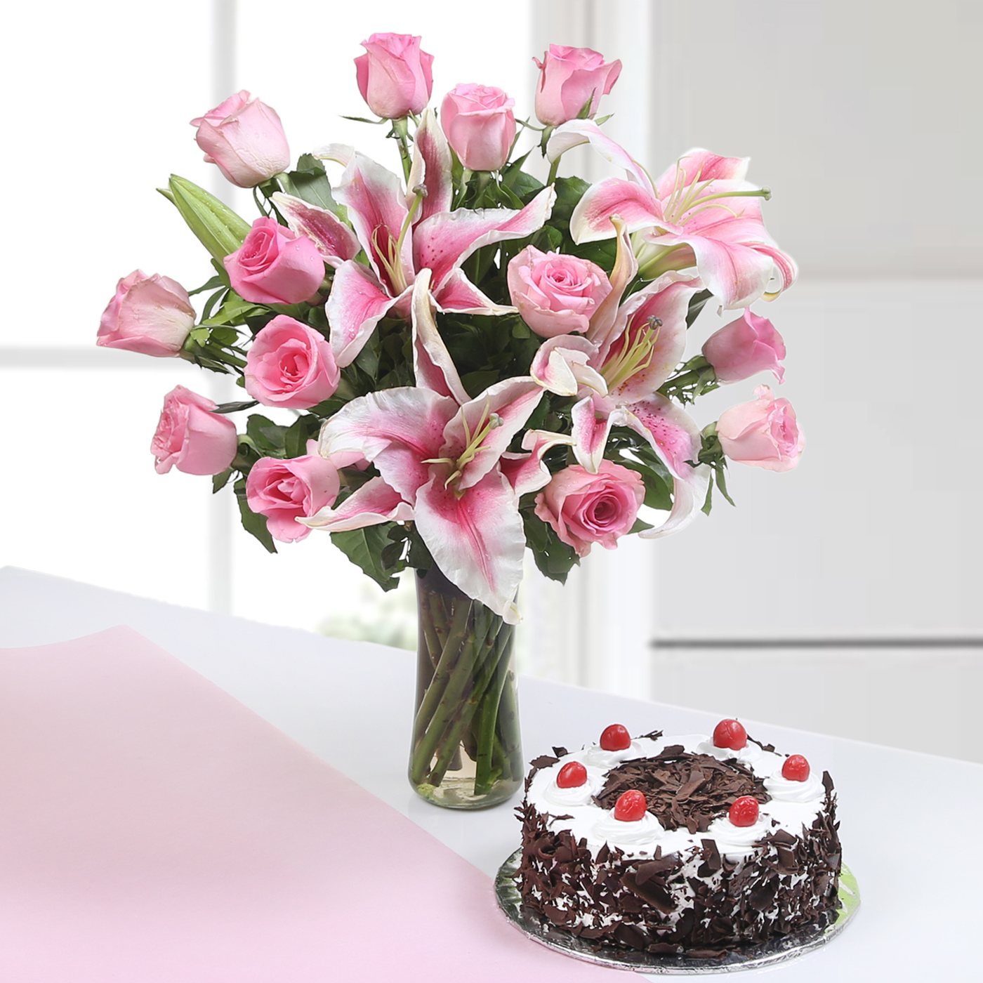 Beautiful 13 Pink Roses & 3 Lilies in a Glass Vase with Round Black Forest Cake