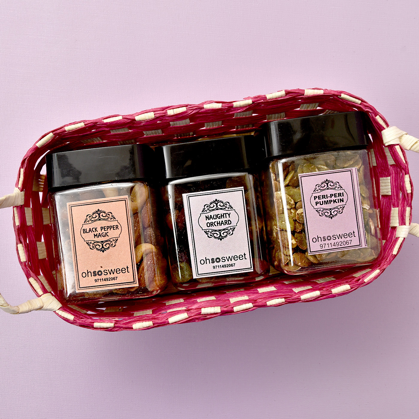 Delightful Flavored Dryfruits & Savouries Cans in Basket