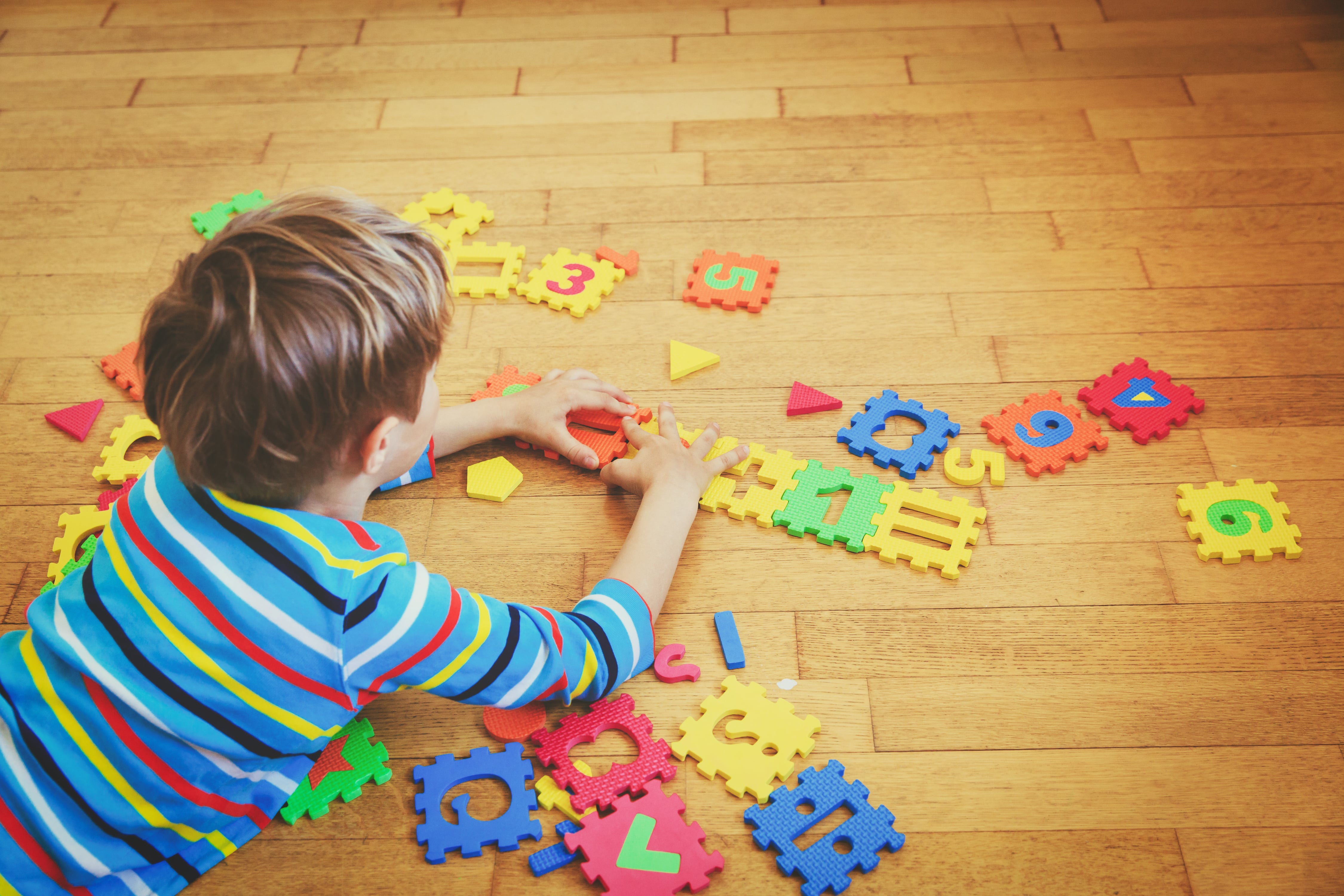 Kid With Puzzle