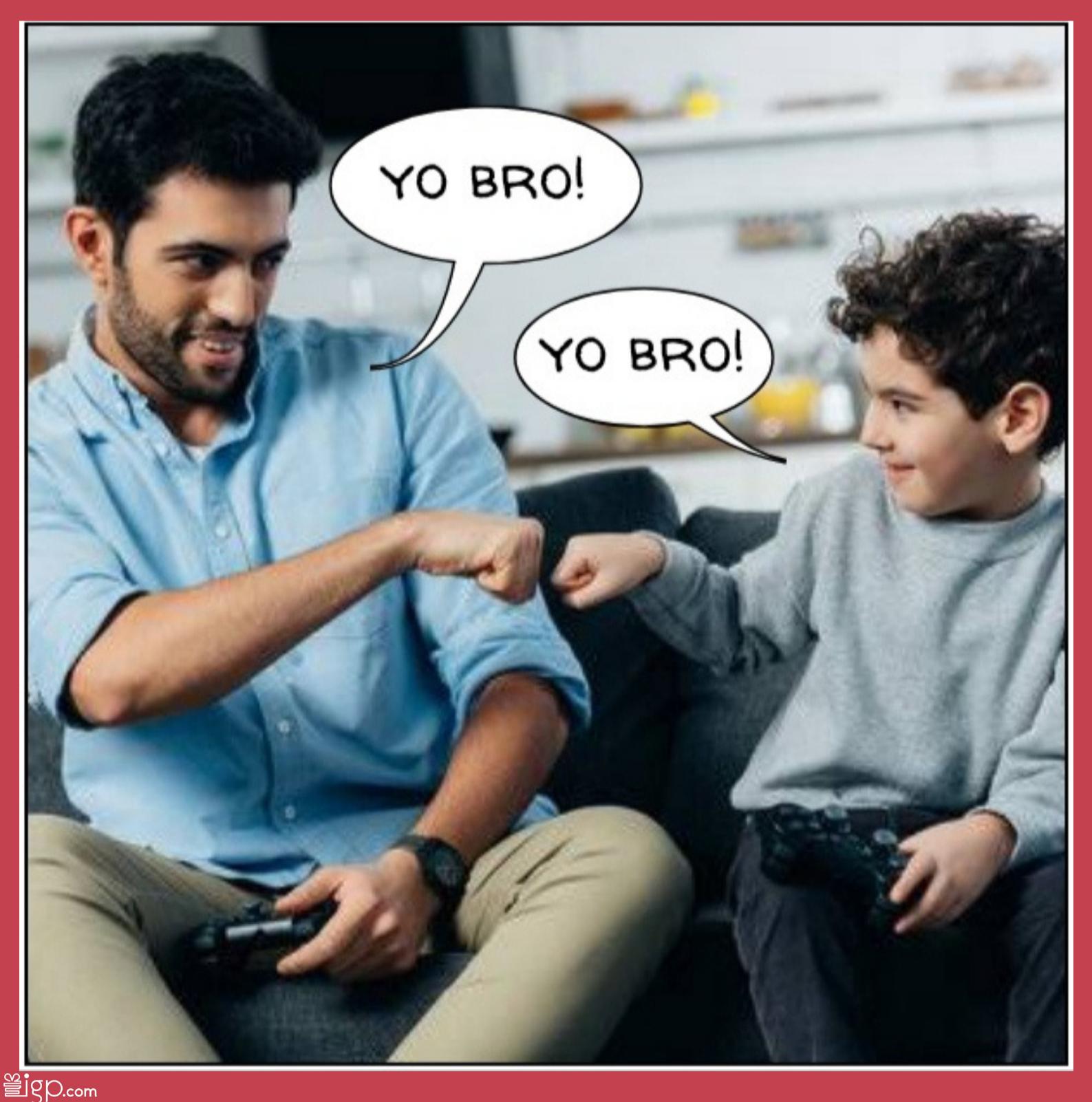 Dad fist bumping son