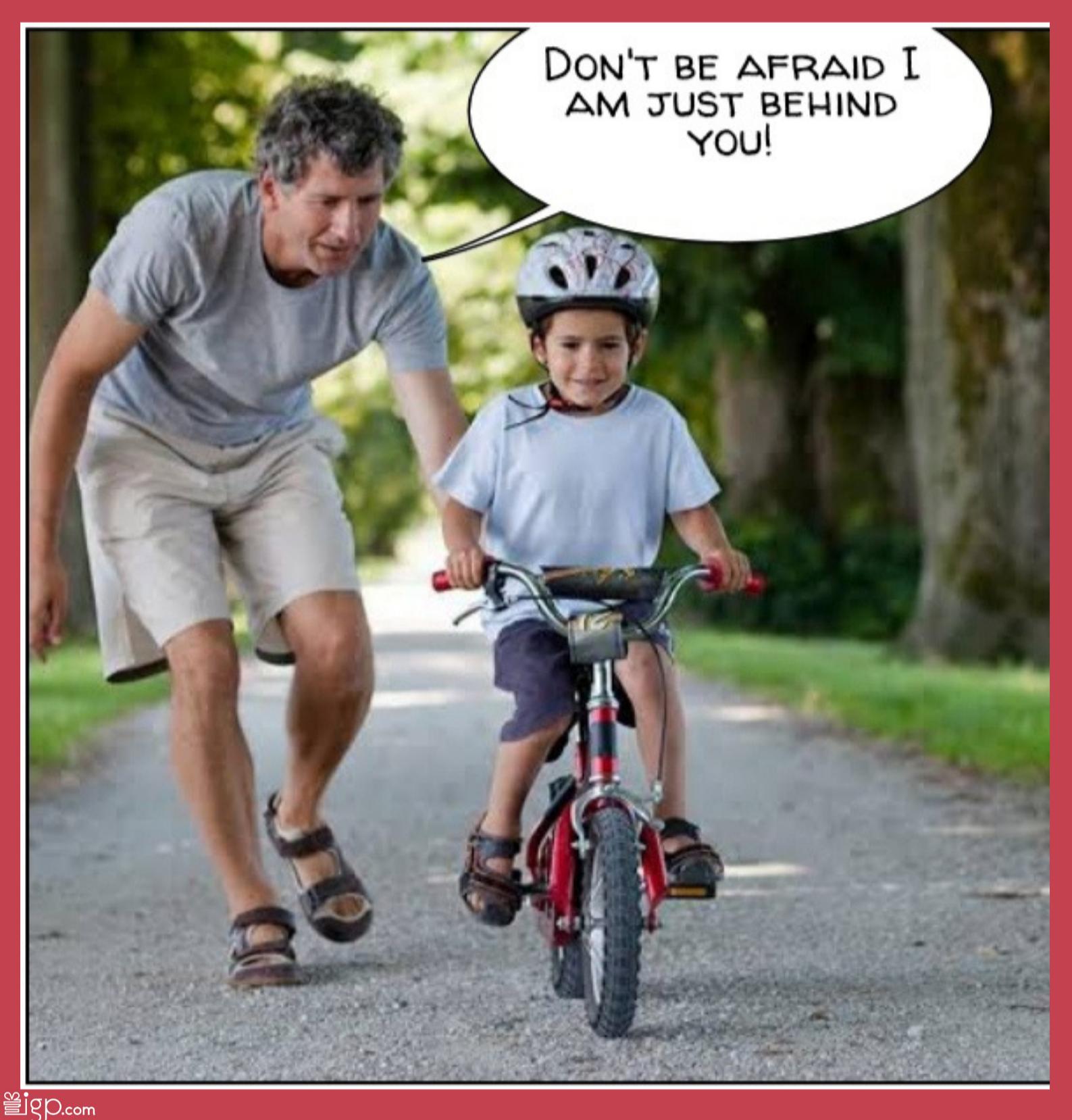 dad teaching son cycling
